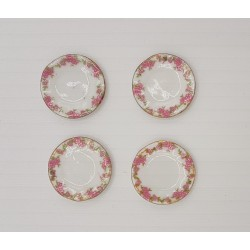 Set of 4 decorated plates