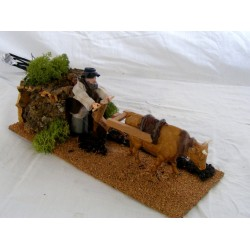 Man and Ox with plow in...