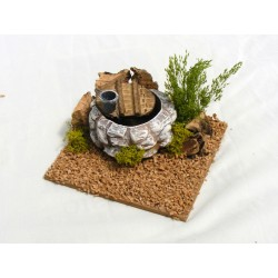 Small terracotta well for...