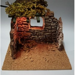 Small terracotta hut with...